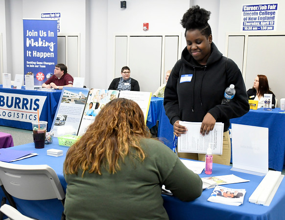 4/12/2018 Mike Orazzi | Staff Essense Womack gathers career information during the Lincoln College Career Fair held on campus Thursday.