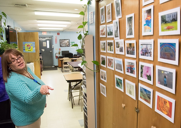 04/11/18 Wesley Bunnell | Staff Director of Youth Services for HRA of new Britain Summer Youth Employment and Learning Program, Leticia Mangual, looks over student art work from previous classes. The program which is located at 58 Scarlett St. helps prepare high school students with training and work experience.