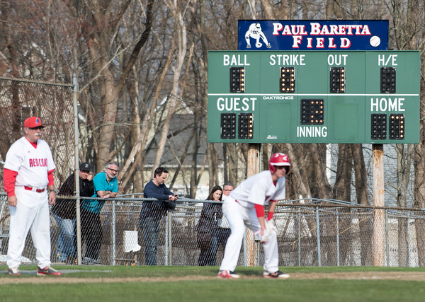 04/13/18 Wesley Bunnell | Staff A Berlin runner at third base with the Paul Baretta Field scoreboard in the background. The Town of Berlin dedicated Paul Baretta Field at Percival Park on April 13th before the Berlin High School baseball game vs Northwest Catholic.