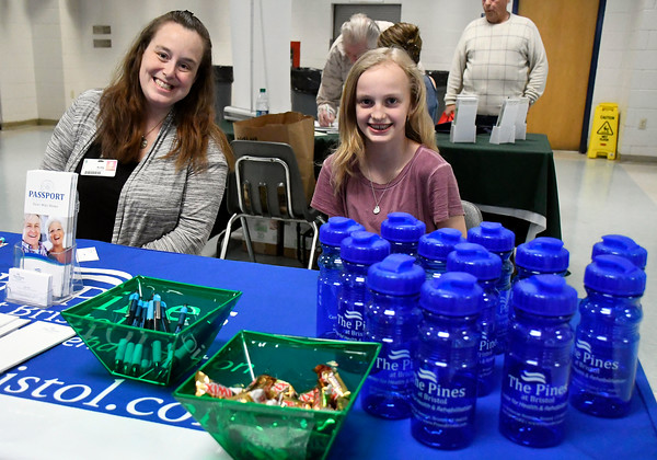 4/14/2018 Mike Orazzi | Staff The Pines' Kelly Dube and her daughter Maidson during the 4th annual Prime Time Senior Fair held at Bristol Eastern High School Saturday.