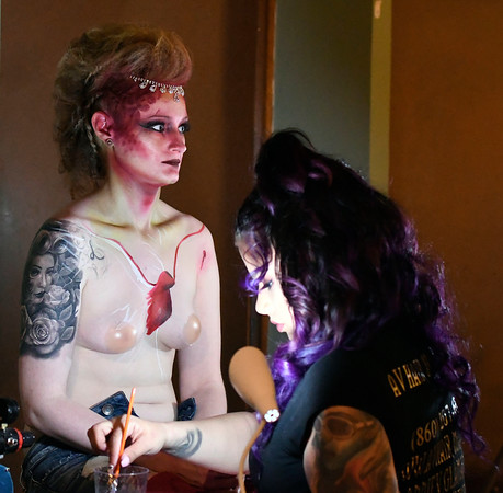 4/14/2018 Mike Orazzi | Staff Lyndsey Adams while having her body painted by Annie Vasquez during CT Swan Day 2018 held at Trinity on Main in New Britain Saturday night.