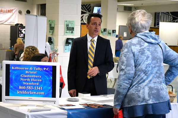 4/14/2018 Mike Orazzi | Staff Kilbourne & Tully's Dean Kilbourne talks with Mary Dudzinski during the 4th annual Prime Time Senior Fair held at Bristol Eastern High School Saturday.