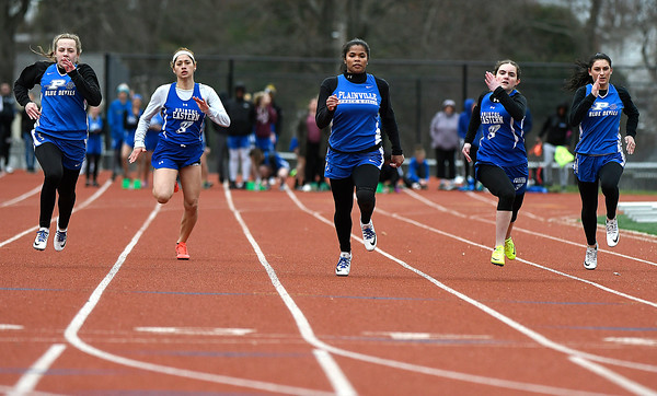4/17/2018 Mike Orazzi | Staff Plainville's Sydni Spencer (center) takes first place in the 100 meter at Bristol Eastern Tuesday.