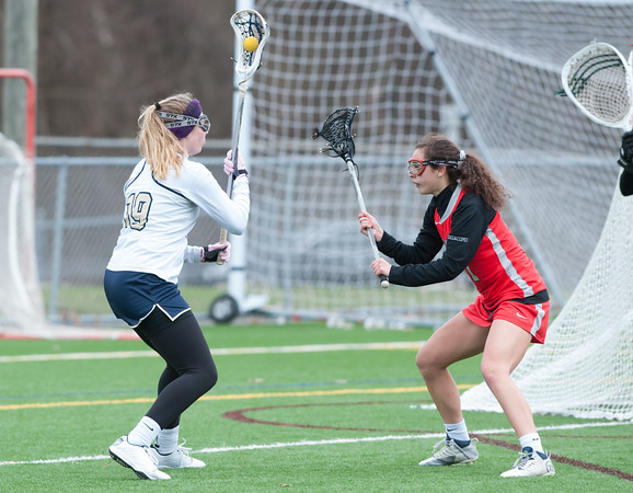 04/17/18 Wesley Bunnell | Staff Newington girls lacrosse was defeated 19-2 by Conard at Newington on Tuesday afternoon. Maya Gajowiak (19) would score late to make it 19-2.