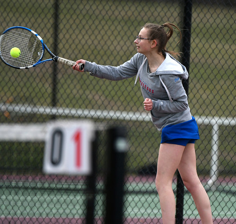 4/18/2018 Mike Orazzi | Staff St. Paul's Katie Pauloz during Wednesday's tennis match with Watertown in Page Park.