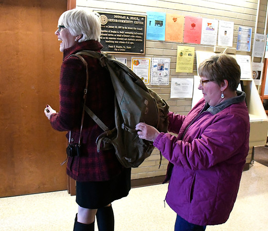 4/20/2018 Mike Orazzi   Staff Helen Ayer Patton shows off a World War II backpack to Judy Kirschner that belonged to her father Herman James Perry.