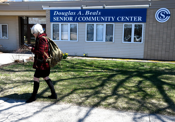 4/20/2018 Mike Orazzi   Staff Helen Ayer Patton while on her way into the Bristol Senior Center with a to return Herman James Perry's World War II backpack to family members.