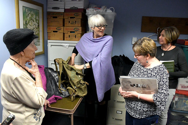 4/20/2018 Mike Orazzi   Staff Helen Ayer Patton returns Herman James Perry's World War II backpack to Dorothy Perry and her daughters Cheryl Chumney and Judy Kirschner at the Bristol Senior Center Friday.