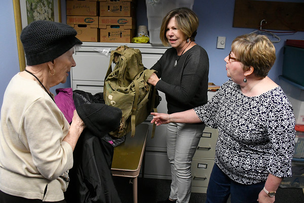 4/20/2018 Mike Orazzi   Staff A World War II backpack that belonged to Herman James Perry after it was returned to Dorothy Perry and her daughters Cheryl Chumney and Judy Kirschner at the Bristol Senior Center Friday.