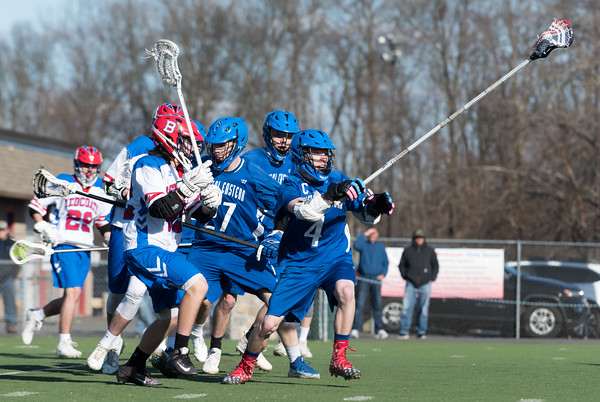 04/20/18 Wesley Bunnell   Staff Berlin boys lax defeated Bristol Eastern 18-3 on Friday afternoon at Sage Park. Zach Hill (4) comes away with the ball.
