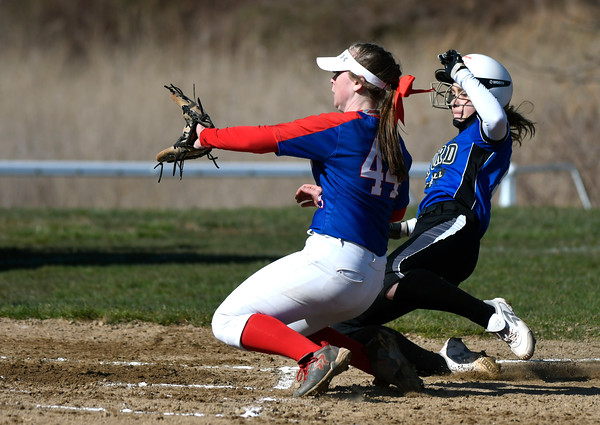 4/20/2018 Mike Orazzi   Staff St. Paul's Abby Poirot (44) tags out Oxford's Sage Borkowski (13) at home Friday.
