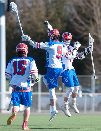 04/20/18 Wesley Bunnell   Staff Berlin boys lax defeated Bristol Eastern 18-3 on Friday afternoon at Sage Park. Kevin Dunn (9) celebrates his goal with teammate Nick Grant (30).
