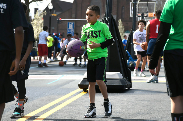 4/28/2018 Mike Orazzi   Staff Northend School's Derrick Sanchez during the annual Hoops for Homeless in downtown New Britain.