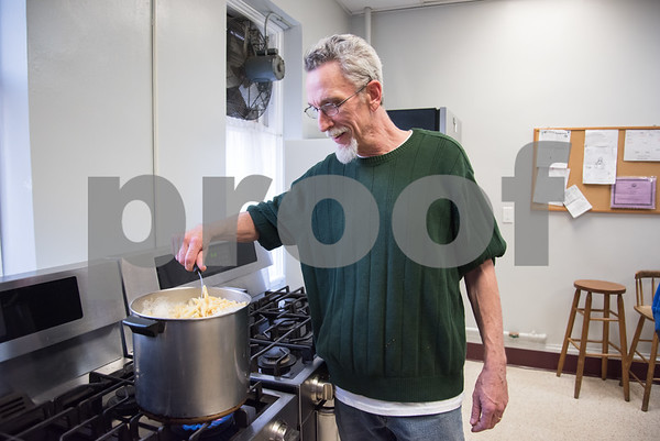 04/06/18 Wesley Bunnell | Staff Kelly Nauss, Sexton of St. Mark's Church, stirs a large pot of pasta in the church's kitchen on Friday evening. The church which is located on W. Main St in New Britain holds a feed the hungry dinner every Friday from 5-6pm for approximately 70-100 individuals relying in large part to donations from the community.
