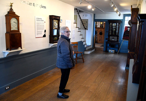 4/7/2018 Mike Orazzi | Staff Angie Parson while looking over clocks on the opening day of the American Clock & Watch Museum in Bristol Saturday.