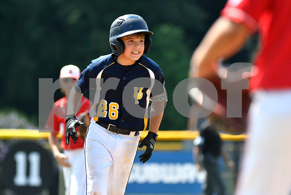 8/9/2017 Mike Orazzi | Staff Pennsylvania's Jake Voynar (26) rips a grand slam home run against New Jersey during the Eastern Regional Little League Tournament in Bristol Wednesday afternoon.