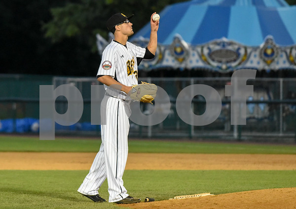 080917 Wesley Bunnell | Staff The New Britain Bees vs the Sugarland Skeeters on Wednesday evening. Brandon Fry (20) looks up at the baseball before coming in relief.