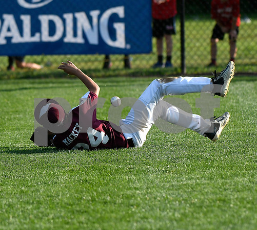 8/9/2017 Mike Orazzi | Staff New Hampshire's Tyler Mackey (24) makes a diving attempt during the Eastern Regional Little League Tournament at Breen Field in Bristol Wednesday.