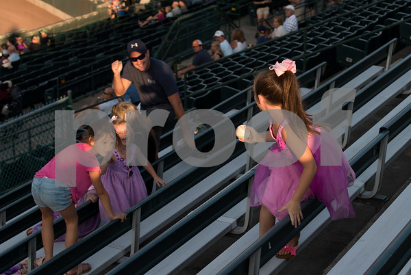 081617 Wesley Bunnell | Staff Dressed for super hero and princess night is Elle Connoy, age 7, as she tracks down a foul ball at the New Britain Bees baseball game on Wednesday evening against the Southern Maryland Blue Crabs.