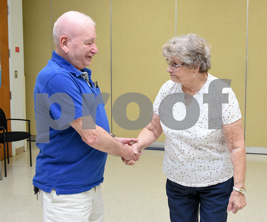 080717 Wesley Bunnell | Staff AARP Tax Aide volunteer Brude Kraft shakes hands with Barbara Dixon at the conclusion of their meeting at the Berlin Senior Center.