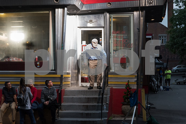 081517 Wesley Bunnell | Staff Filming for the movie Christmas Hours at Miss Washington Diner on Tuesday night. Actor Brian Dennehey exits the diner between filming.