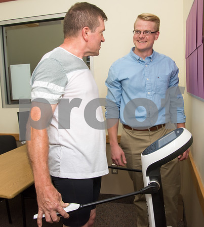080117 Wesley Bunnell | Staff Healthtrax member Gary Gelinas, L, undergoes a body assessment with Physician Liaison for the Healthtrax Physicians Referral Program, P.R.E.P, Tim Cederberg at Healthtrax in Bristol on Tuesday Aug 1st.