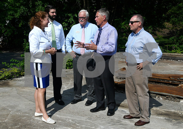 8/3/2017 Mike Orazzi | Staff Congresswoman Elizabeth Esty talks with Tim Sullivan,Department of Economic and Community Development, State Rep Whit Betts, Plymouth Mayor Dave Merchant and State Senator Henri Martin while touring the Old Mayfair Garage Property off Route 6 Thursday afternoon.