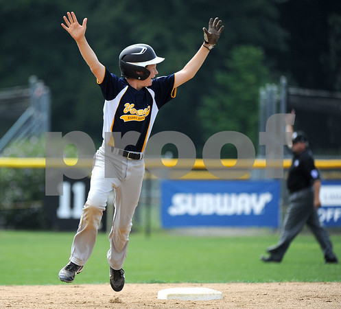 8/10/2017 Mike Orazzi | Staff Vermont's Eli Bostwick (2) celebrates a home run by his teammate Andrew Goodrich (8) during the Eastern Regional Little League game at Breen Field in Bristol Thursday.