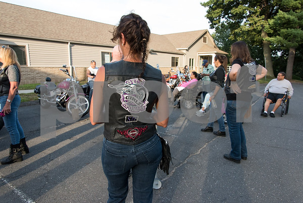 081717 Wesley Bunnell | Staff Autumn Lake Healthcare in New Britain held a motorcycle night on Thursday for residents. Linda Faust of the Out Spoken Girls Motorcycle Club with the patch on the back of her vest.