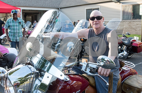 081717 Wesley Bunnell | Staff Autumn Lake Healthcare resident David Gormley sits atop Mary Mixter's motorcycle during motorcycle night at the facility. Mixter is a member of the Out Spoken Girls Motorcycle Club.