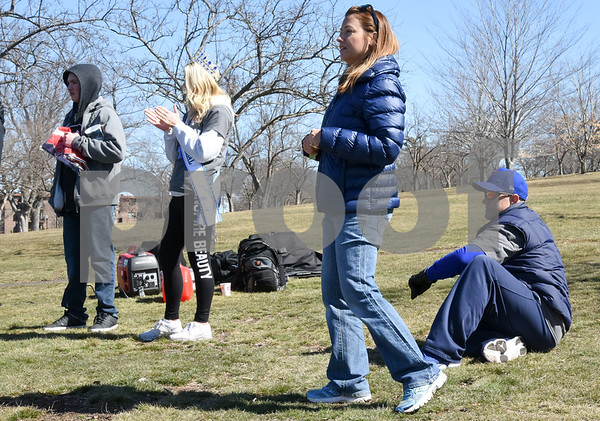 040217 Wesley Bunnell | Staff Team Johnson Walk took place on Sunday April 2, 2017 in Walnut Hill Park. 100% of the proceeds collected are being donated to the Fight Colorectal Cancer Foundation. The walk was organized by Caroline Johnson, wife of New Britain Firefighter Scott Johnson, who is currently being treated for the disease. Standing on the hill overlooking the walkers at the conclusion of the event are , second from the left, Mrs. CT USA Universal Kim Beaudoin, Caroline Johnson and Scott Johnson.