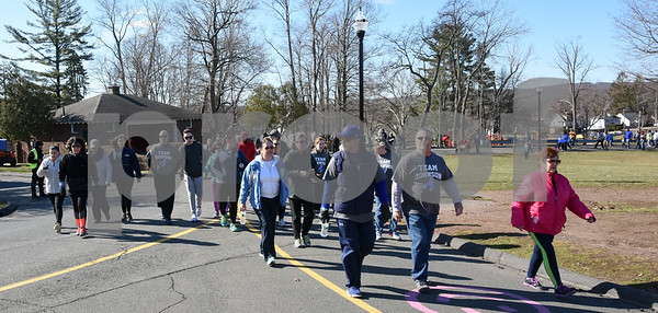 040217 Wesley Bunnell | Staff Team Johnson Walk took place on Sunday April 2, 2017 in Walnut Hill Park. 100% of the proceeds collected are being donated to the Fight Colorectal Cancer Foundation. The walk was organized by Caroline Johnson, wife of New Britain Firefighter Scott Johnson, who is currently being treated for the disease. Scott Johnson, near the end of the lap around Walnut Hill Park.
