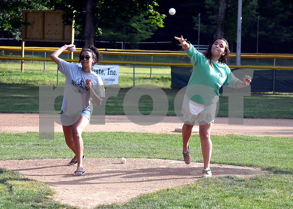 8/1/2017 Mike Orazzi | Staff Bob Watson's grand daughters Courtney and Taya Watson throw out the first pitches during the Bob Watson Little League tournament held at Peck Park Tuesday at the Forestville Little League.