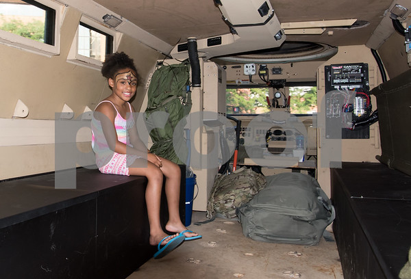 080117 Wesley Bunnell | Staff The New Britain Police Department hosted their annual National Night Out event in downtown New Britain on Tuesday night. The night featured activities, demonstrations and giveaways including a barbecue to encourage residents to help stop crime. Keyanna Wellington, age 10, sits inside of a SWAT armored vehicle.