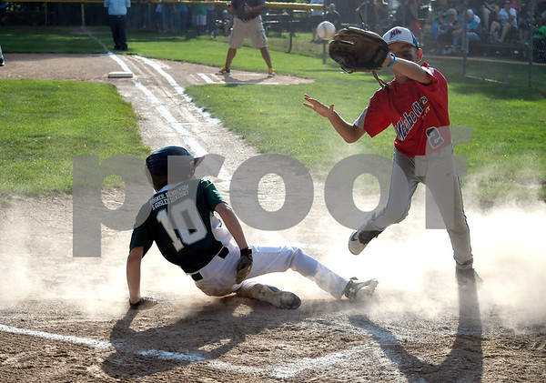 8/1/2017 Mike Orazzi | Staff Forestville's Camden Michaud (10) scores as McCabe Waters' Mason Allen covers the plate during Tuesday night's game with Forestville in Peck Park.