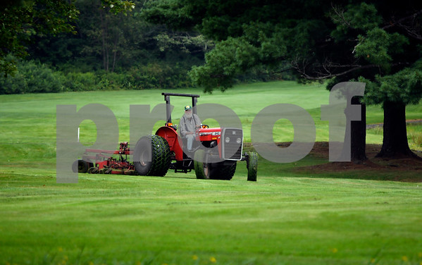 8/15/2017 Mike Orazzi | Staff Grass mowing at Chippanee Golf Club in Bristol Tuesday morning.