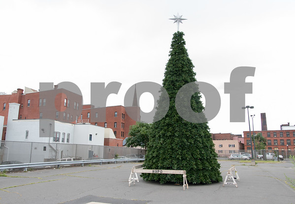 081517 Wesley Bunnell | Staff A large Christmas Tree sits in a parking lot on Court St in New Britain on Tuesday afternoon. The tree is part of the movie Christmas Hours which is being filmed in New Britain and Bristol featuring Melissa Joan Hart and Mario Lopez.
