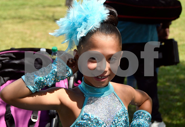 8/19/2017 Mike Orazzi | Staff Kayleen Torres of the X-Dance group waits to perform during the citys second annual Latin Festival in New Britain Saturday.