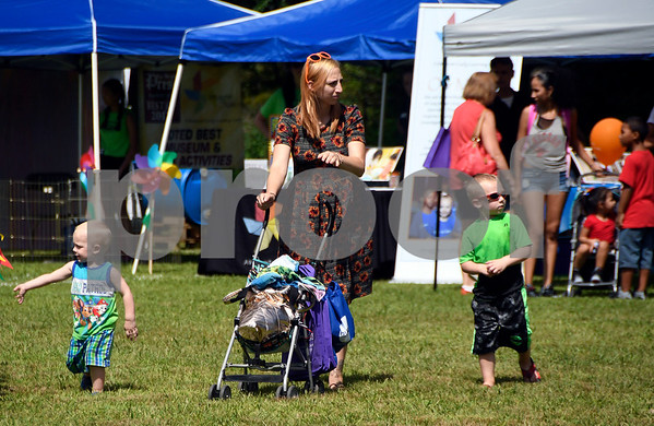 8/19/2017 Mike Orazzi | Staff Casey Hanscom and her sons Wyatt,2 and Connor,4 during the Rockwell Park Summer Festival 2017 hosted by West End Association of Bristol Saturday.