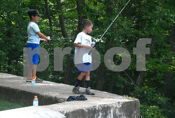 8/2/2017 Mike Orazzi | Staff Garett Lebowitz and Cole Chaivanik while fishing at Birge Pond in Bristol Wednesday morning.