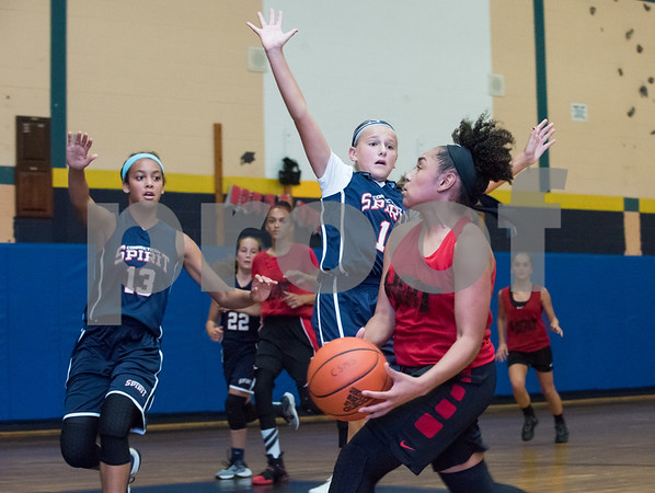 Adriana Faienca (2) of the CT Heat drives to the basket against the CT Spirit on Wednesday night at Roosevelt School in a 12U Nutmeg State Games competition.
