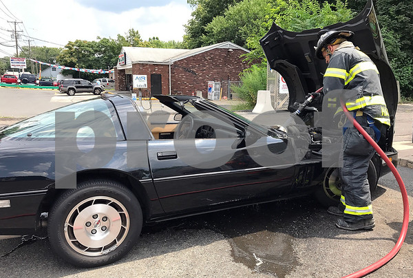 8/2/2017 Mike Orazzi | Staff Bristol firefighters extinguish a car fire in Juan Ayala's 1986 Chevrolet Corvette after he spotted and engine fire and pulled over in the 100 block of Riverside Avenue Wednesday afternoon. No one was injured and he planned to have the car towed from the scene.