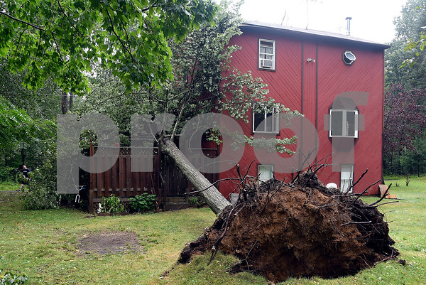 8/2/2017 Mike Orazzi | Staff Damage after a strom downed a tree onto a home on Carol Circle in Plymouth Wednesday afternoon.
