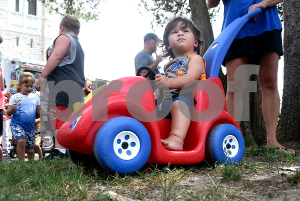 8/22/2017 Mike Orazzi | Staff Gabe Soto,1, during the United Way of West Central Connecticut's 2017 ice cream & book distribution held on the Federal Hill Green Tuesday morning. Students and parents were given free ice cream, and a chance to meet their school principals at the annual event. Gabe was there to support his older brother Reinaldo.