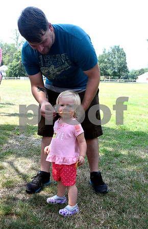 8/22/2017 Mike Orazzi | Staff Jason Bonvisuto and his daughter Savannah, 1.7 years old, during the United Way of West Central Connecticut's 2017 ice cream & book distribution held on the Federal Hill Green Tuesday morning. Students and parents were given free ice cream, and a chance to meet their school principals at the annual event.