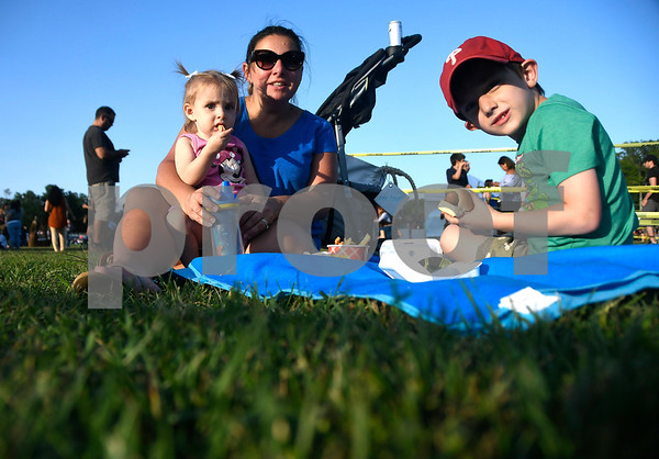 8/25/2017 Mike Orazzi | Staff Andrea Mead with her children Charlotte and Ben at the Plainville Fire Company Hot Air Balloon Festival held in Norton Park Friday night.
