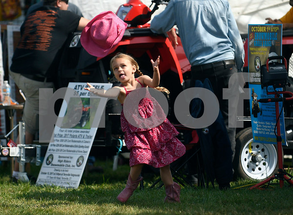 8/26/2017 Mike Orazzi | Staff Jacqueline Hancock,5, throws her hat into the air while at the Terryville Lions County Fair Saturday morning.