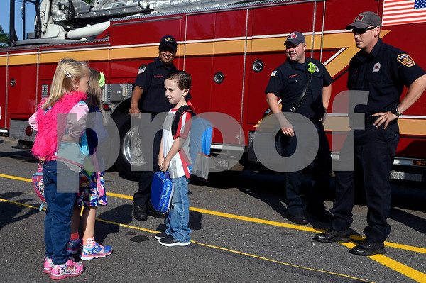 8/31/2017 Mike Orazzi | Staff Leon Blais talks with classmates after arriving on Tower 1 at the Stafford School for the first day of school in Bristol Thursday.