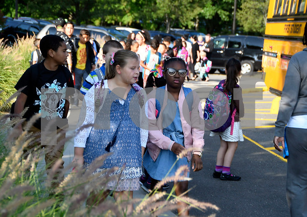 8/31/2017 Mike Orazzi | Staff Stafford School students arrive on the on the first day of school in Bristol Thursday.