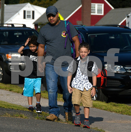 8/31/2017 Mike Orazzi | Staff Ben Cipes arrives at the Stafford School with his twin boys James and Jackson on the first day of school in Bristol. Thursday.